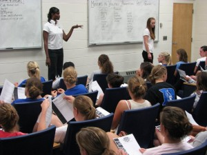 MVP's Shannon Spriggs and Jessica Bartter lead female athletes at Duke University through an MVP Playbook scenario discussion in 2008.